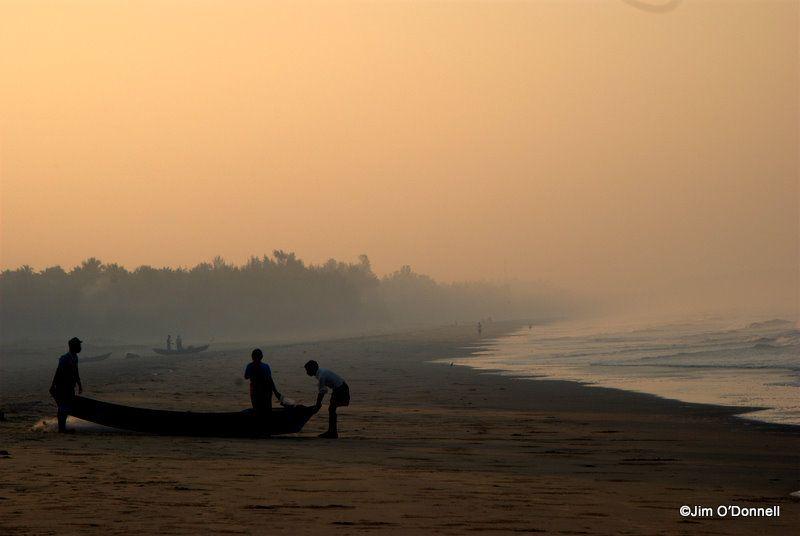 Fishermen prepare to head out on the Arabian Sea as dawn nears.