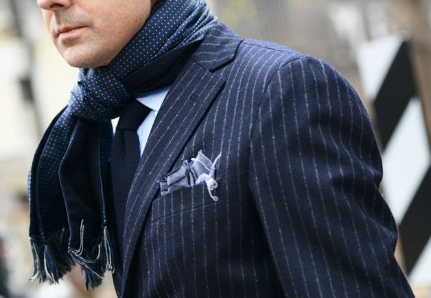 Pattern game: Navy blue chalk stripe coat meet navy blue pindot scarf, in the same color family.