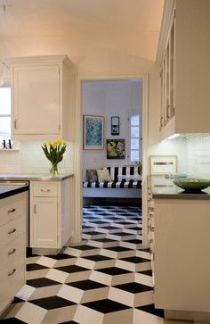 Geometric pattern in Los Angeles floor installation of Congoleum Vinyl Composition Tile (VCT) in black, white, and gray.This artistic cube floor design creates a 3-d optical illusion and supports the black and white home decor (notice the black and white striped bench in the next room).