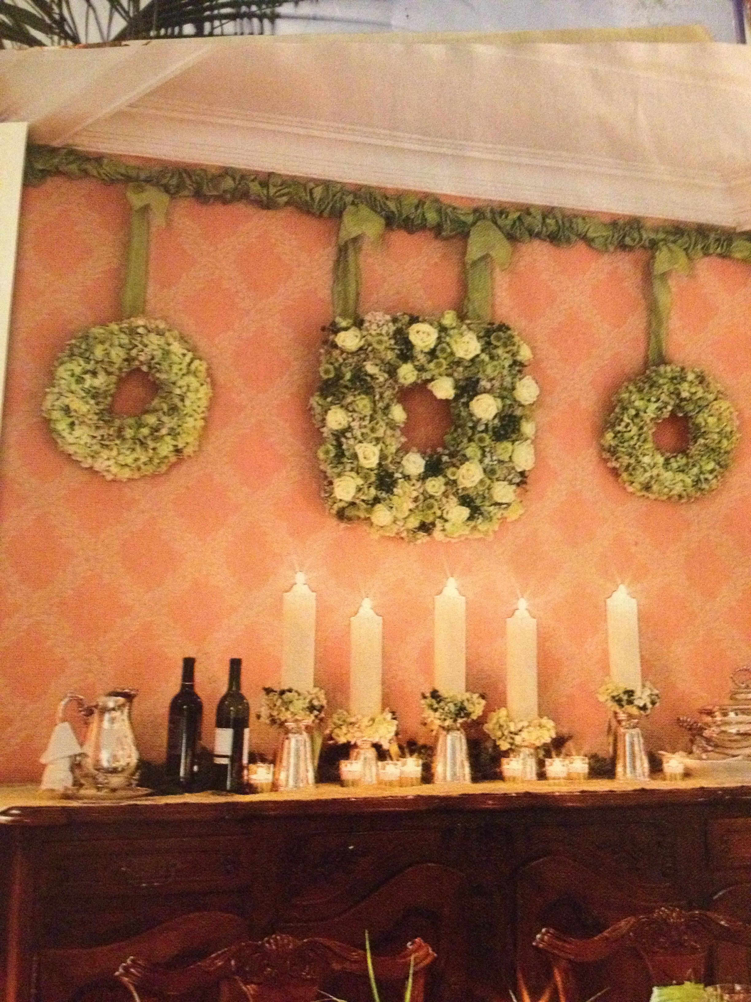 Wreaths hanging from curtain rod