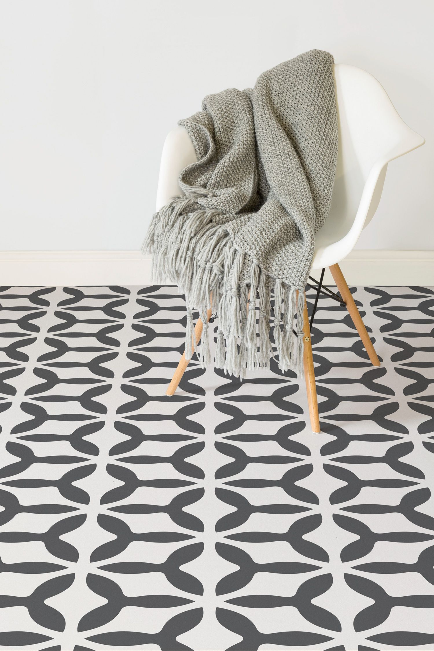 After an instant art deco look? This pattern vinyl flooring design will instil a vintage feel to your home. Simple black and cream help to give a wonderful contrast that is stylish yet versatile.