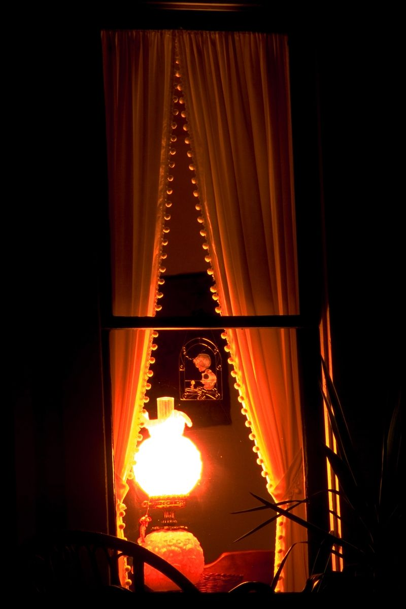 Window at night from outside - Looking Through Night Windows A Lamp Glows From Inside