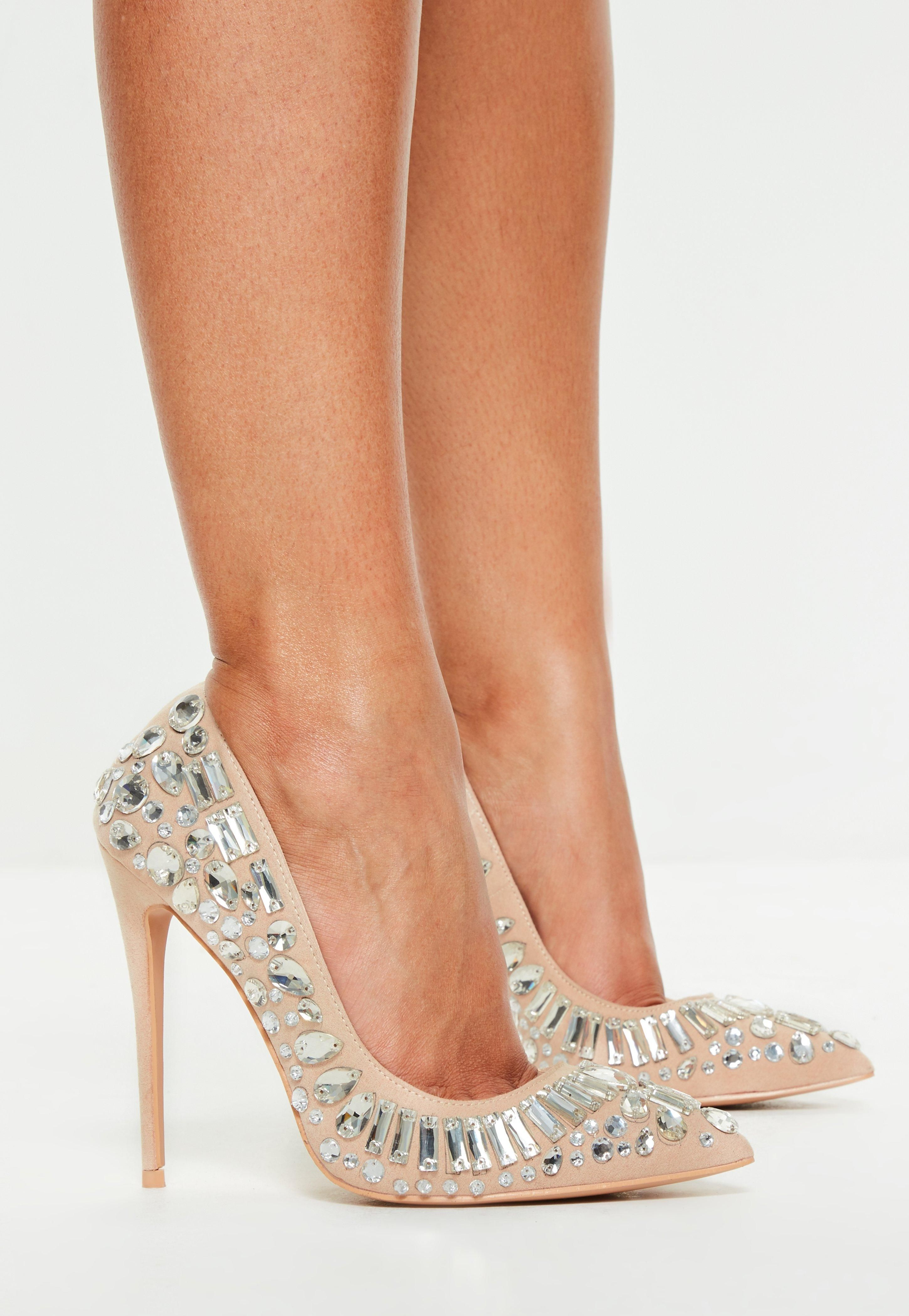 These nude pointed toe heeled mules with clear cover to