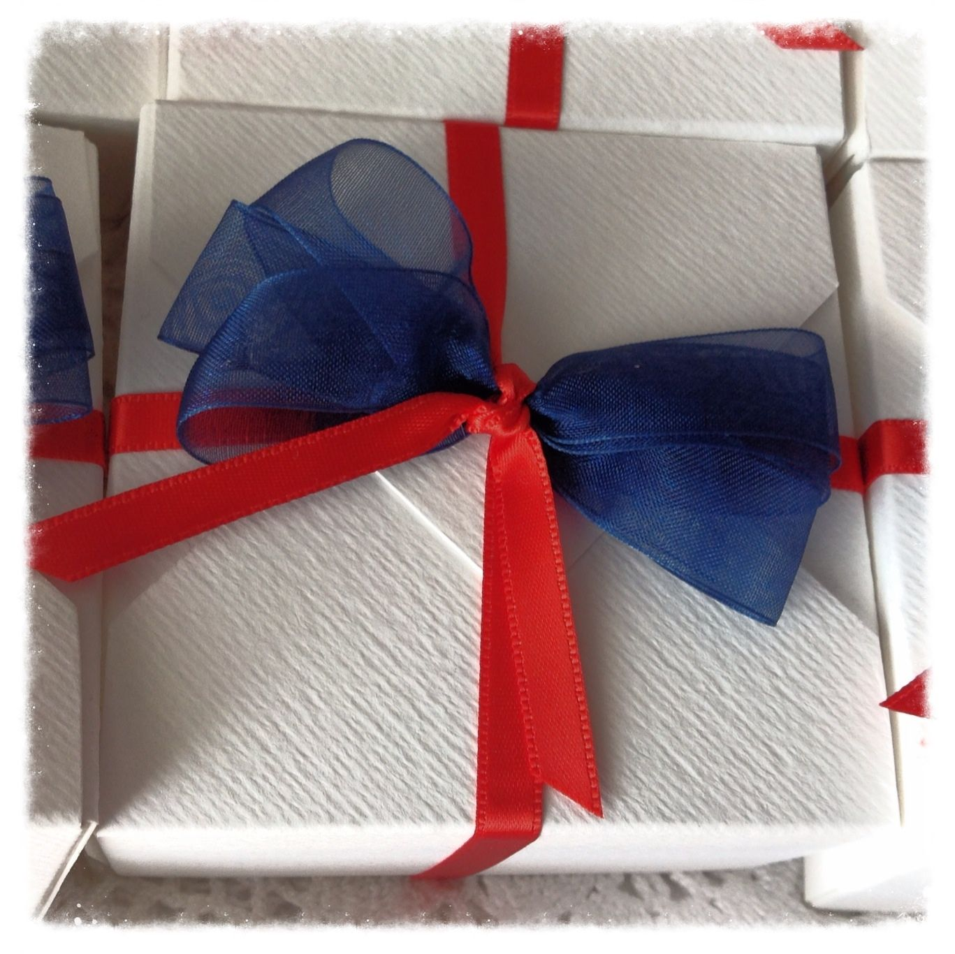 Christening favors - for a boy, of course. White + red are traditional. Love the added touch of blue.