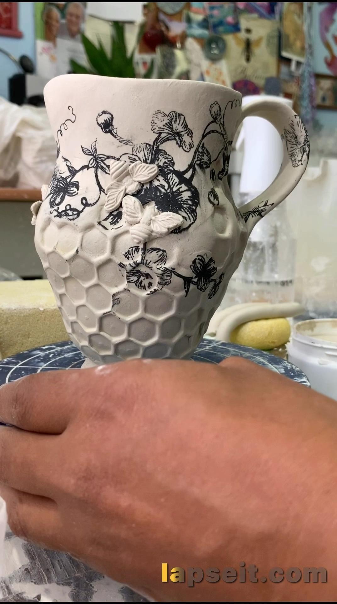 Honeycomb beehive in a flower garden mug.