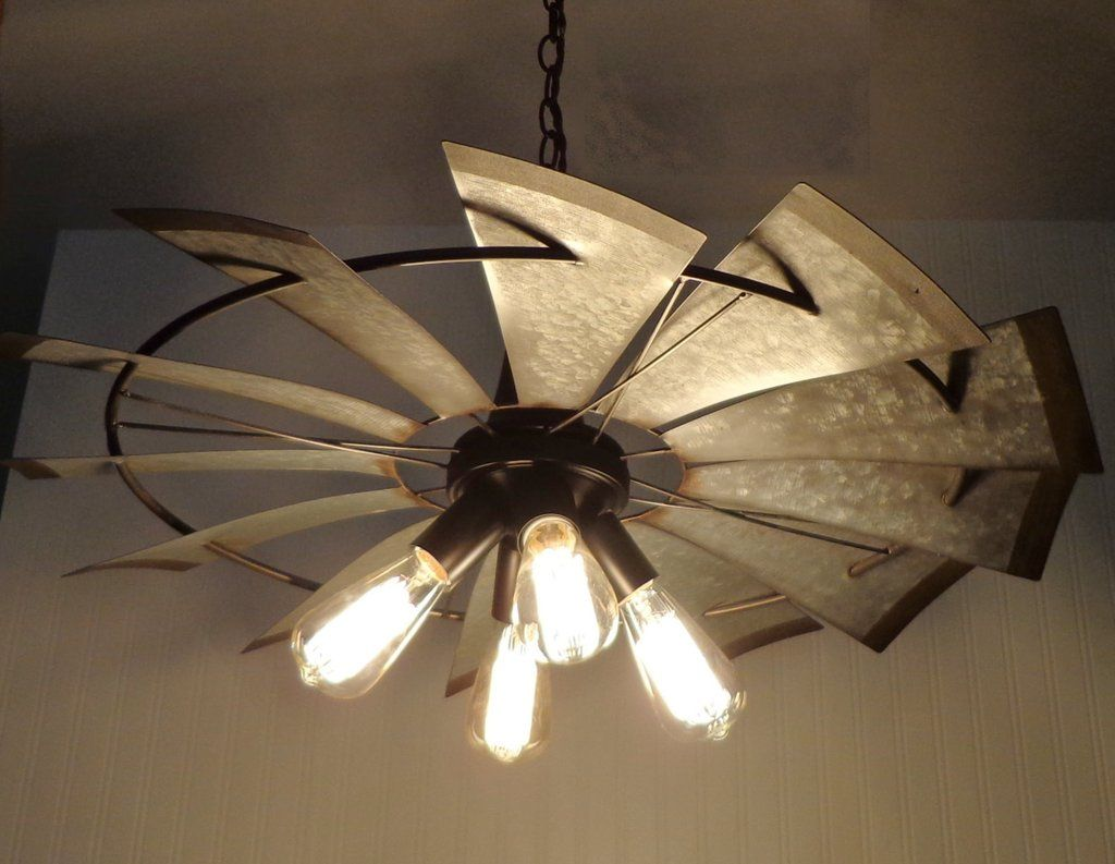 lead designer has done it again with this chandelier featuring an original heavy galvanized windmill