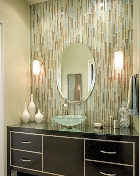 incorporating glass tiles in your bathroom or kitchen is a continuing trend from a complete wall of glass tiles to just a bit of glass pieces for accents