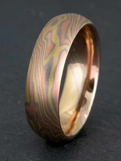 Mokume Gane ring by artist James Binnion with a striking mix of three metals.