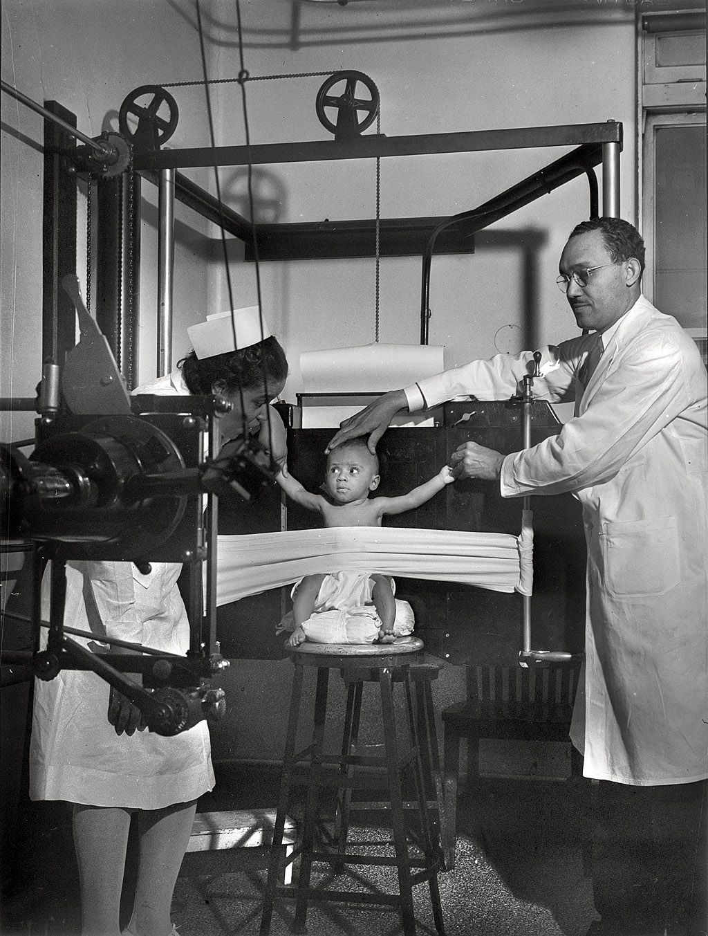A baby is restrained for an Xray at Provident Hospital in