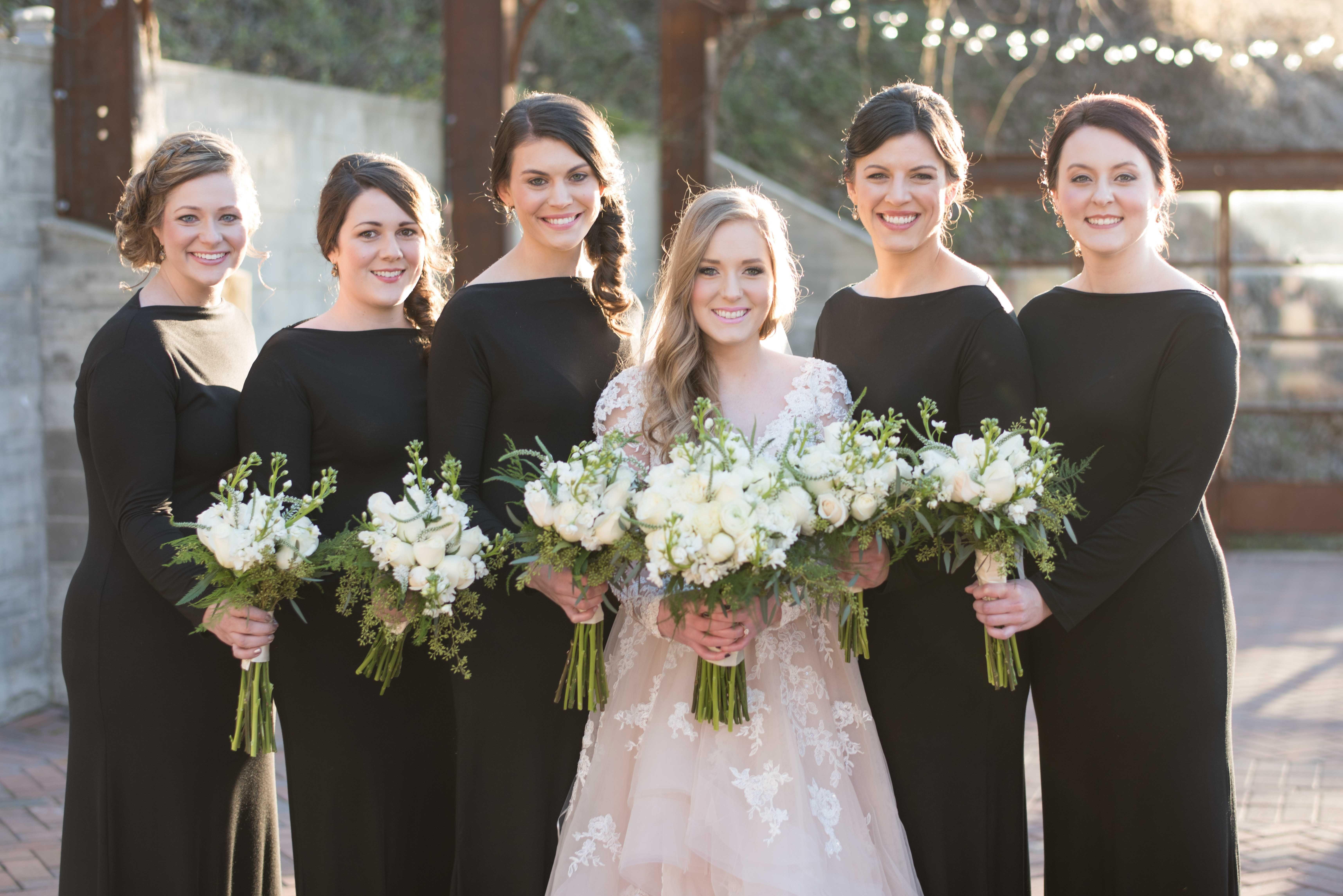 Black bridesmaid gowns.