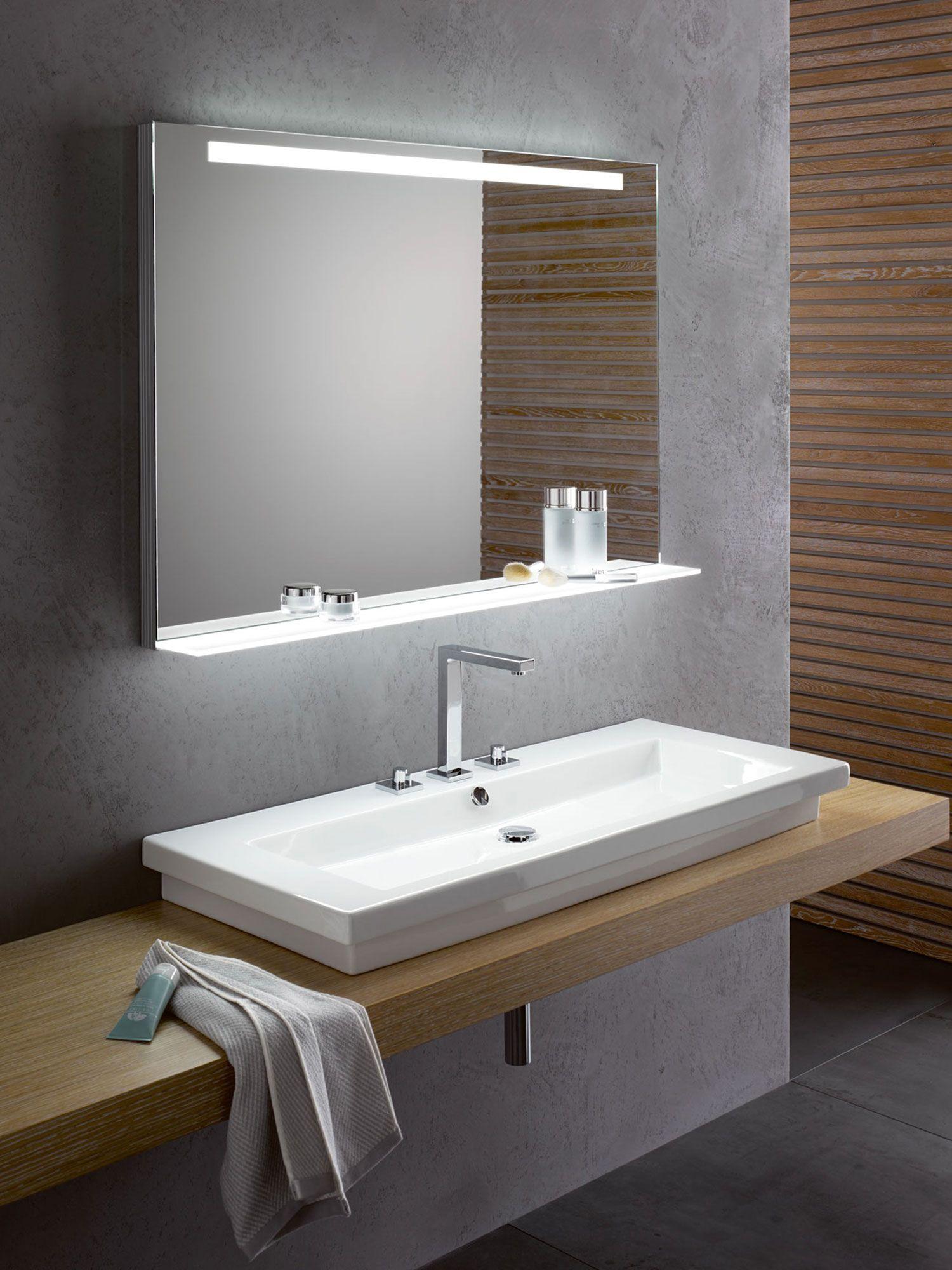 Zu vielen Designer-Waschtischen ist unser VEGAS die ideale Ergänzung. Vor allem, wenn der Waschtisch keine Ablagemöglichkeit für Kosmetika, Zahnputzbecher und Rasierutensilien bietet. Wenn es also darum geht, dass eine Ablage nicht nur funktional ist, sondern dabei auch noch faszinierend aussehen kann, geht der VEGAS im wahrsten Sinne des Wortes mit leuchtendem Beispiel voran. #vegas #lichtspiegel #mirror #designspiegel  #praktisch #interiorbathdesign #manufaktur #betonbathroom #zierath
