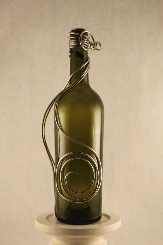 Green glass bottle draped with a wire art design.  by MissBeezz, $45.00