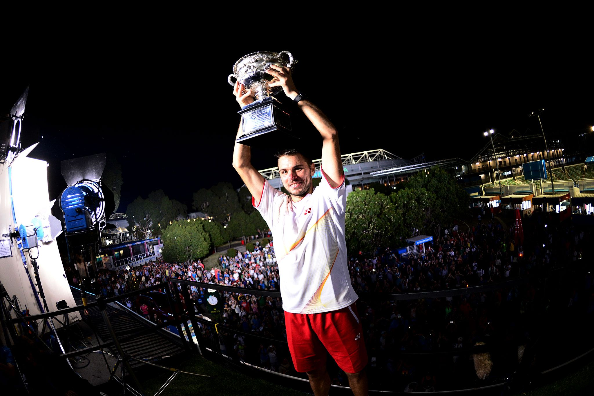 Stan Wawrinka holds up the Norman Brookes Challenge Cup Ben