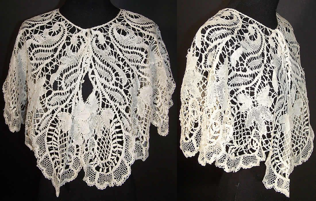 This Victorian era antique white beds maltese bobbin lace collar capelet dates from 1890. It is hand made of a sheer off white bobbin lace beds maltese style with petal leaves, flowers, scrolling pattern designs and connecting brides and bars. This lovely large lace round collar shawl style capelet has a scalloped trim bottom edging and snaps have been added on the front for closure.