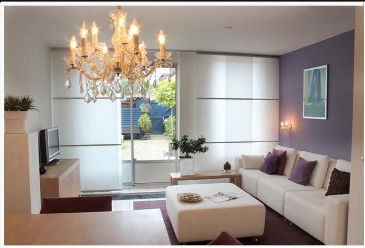 Kleine woonkamer met ruimtelijk effect designed by www.marstyling.nl