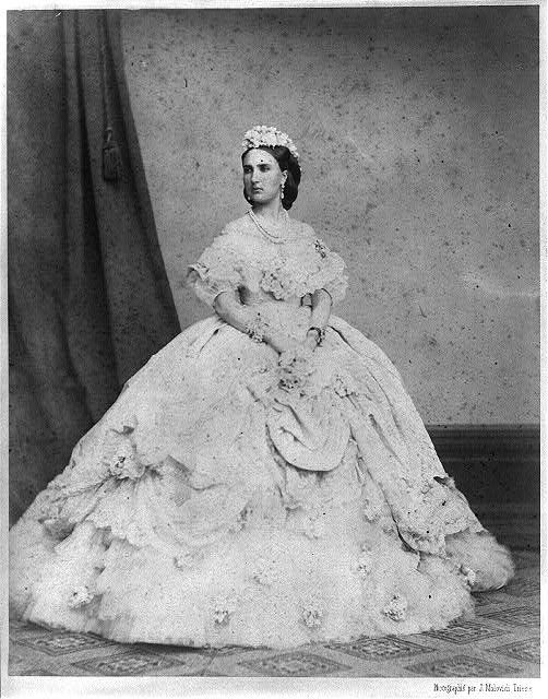 Now that is a huge hoopskirt! This is the same style of hoop that I enjoy wearing and I like her dress too. Hmm must go find some Civil War re-enactors...