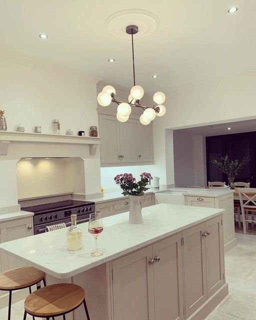 —@our_victorian_adventure - 🌟🌟Saturday eve = Little Mix the Search and M&S glitter globe G&T (it's almost Christmas right ⛄️ 😝) 🌟🌟 . . . . . #newkitchen #globelights #victorianrenovation #victorianreno #myperiodinterior #myperiodhomestyle #neutraldecor #interiormilk #farrowandballskimmingstone #farrowandballelephantsbreath #rangecooker #shakerkitchen #pinelandkitchen #quartzworktops #kitchenisland #myhomedecor #oldhousenewhome