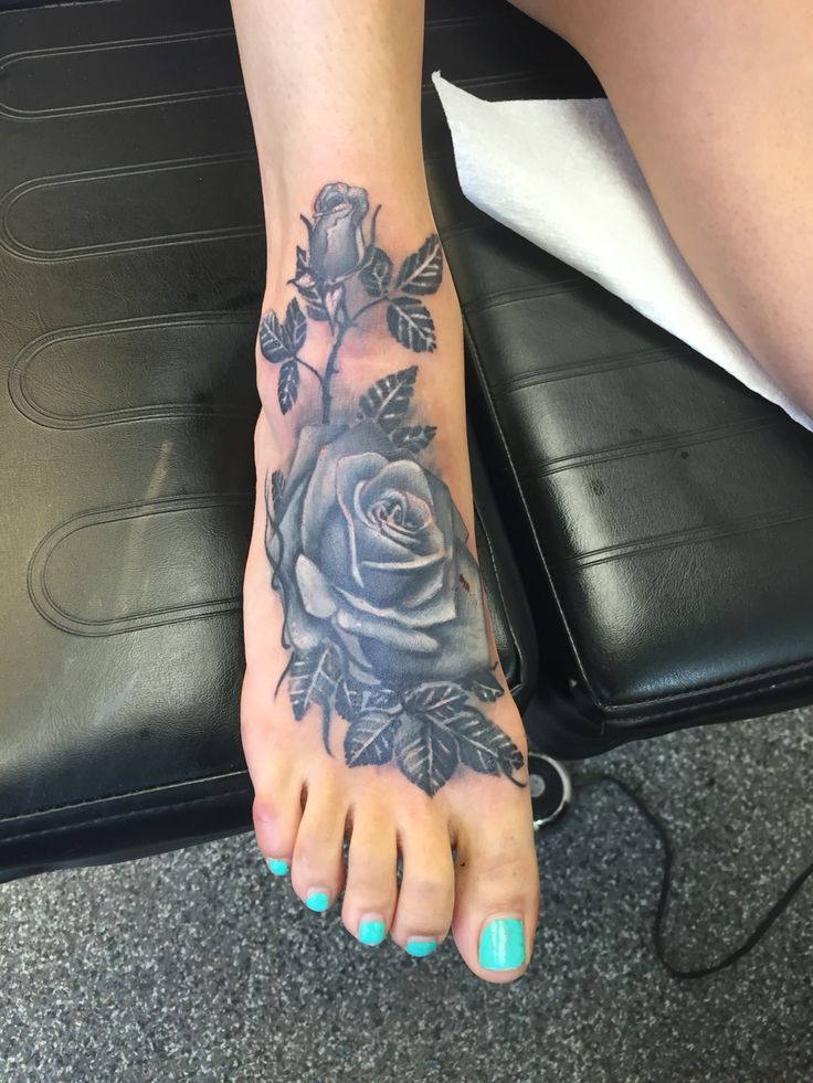 My black and grey rose cover up foot tattoo Tattoos for