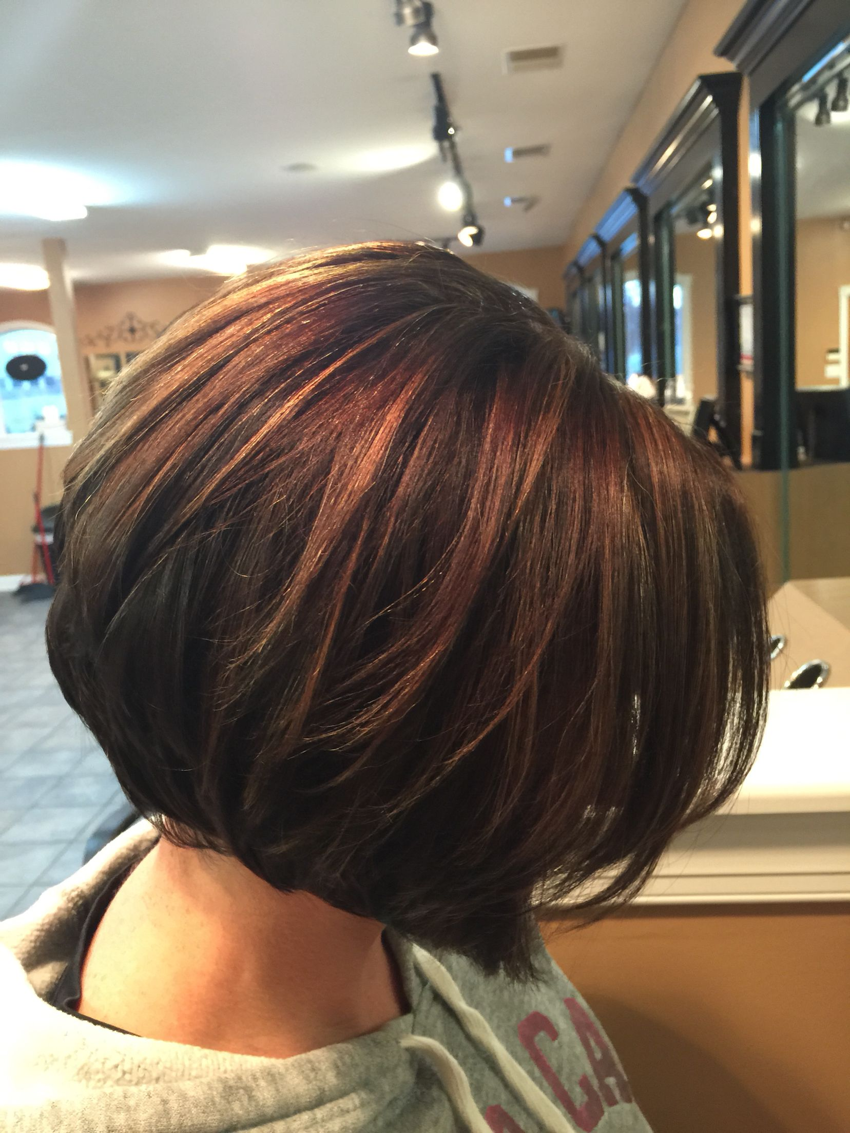 Inverted bob Chocolate brown with caramel highlights By Deanna