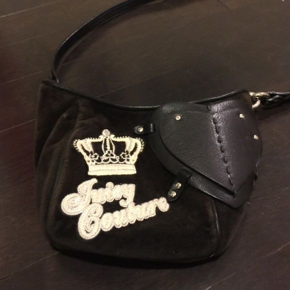 Juicy Couture Crossbody bag in black Big double hearts leather.  Used but in fine condition.  Not used many times!  Good with any kind of outfit. No trade! Juicy Couture Bags Crossbody Bags