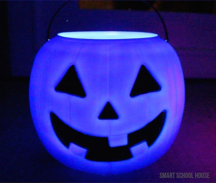 Glowing Pumpkin Pails - Decorate for Halloween in 30 seconds by setting out these glowing pumpkin pails! I got the colorful pumpkins for one dollar!