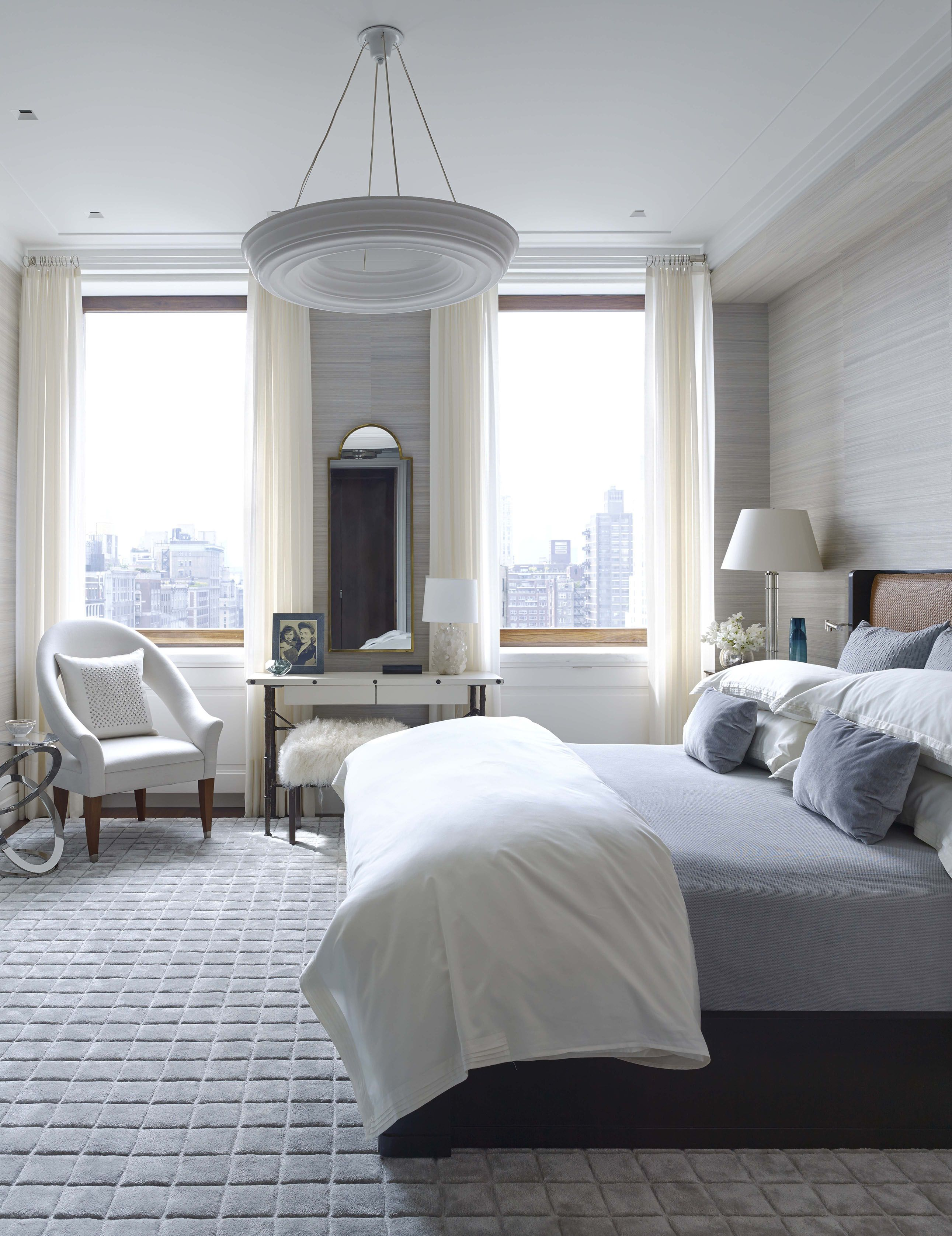 Master bedroom gray  Shades of gray in different textures define the transitional style
