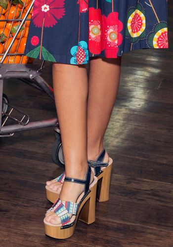Once you buckle into these retro pumps, you'll feel downright out of sight! Boosting your look with navy leather ankle straps, brightly embroidered toe bands, brassy studs, and faux-wood soles, these block-heeled beauts are ready to bust a groove. Talk about far 'haute'!