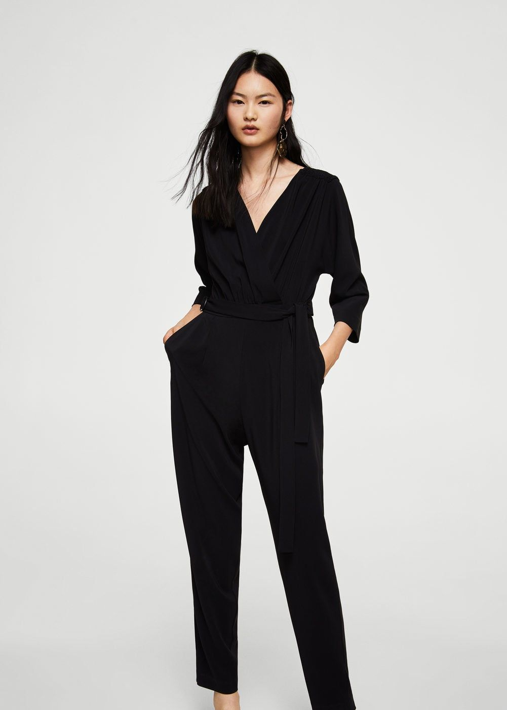 40b2fbd7e3 Flowy fabric Long design Wrap neckline Long sleeve Back zip closure  Jumpsuit Mango