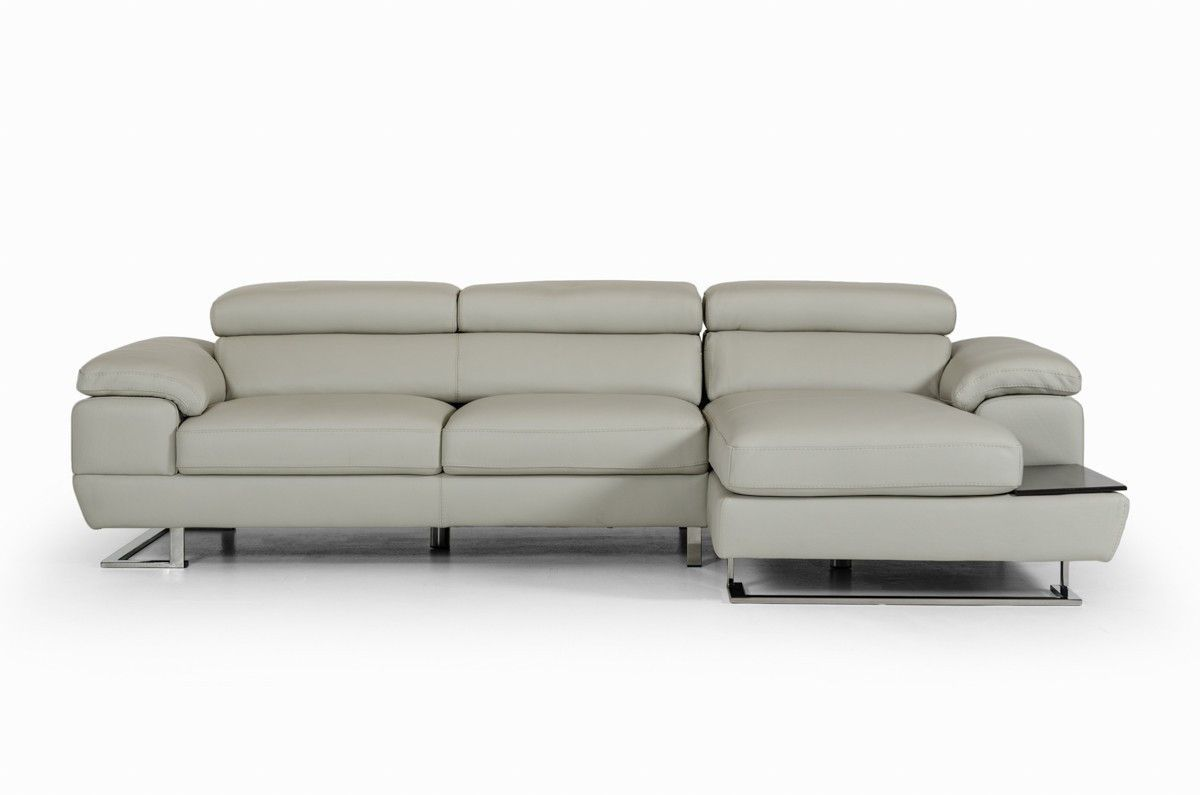 Estro Salotti Invictus Modern Grey Leather Sectional Sofa - VGNTINVICTUS-GRYProduct :71355Features :Upholstered In Full LeatherColor: Pearl Grey Cat F 122Right Facing ChaiseSliding SeatsAdjustable HeadrestsBlack Oak Veneer Side TraySeat Cushions Are Springs Encased In Foam To Prevent SaggingStainless Steel LegsHandmade In ItalyAvailable In Other Upholstery By Special Order (10-16 Weeks)Dimensions :Sectional Sofa :LAF 3 Seater: W69