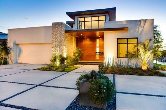 Garageneinfahrt gestalten  vorgarten gestalten einfahrt-kies-dunkelgrau-schlicht-beete-idee ...