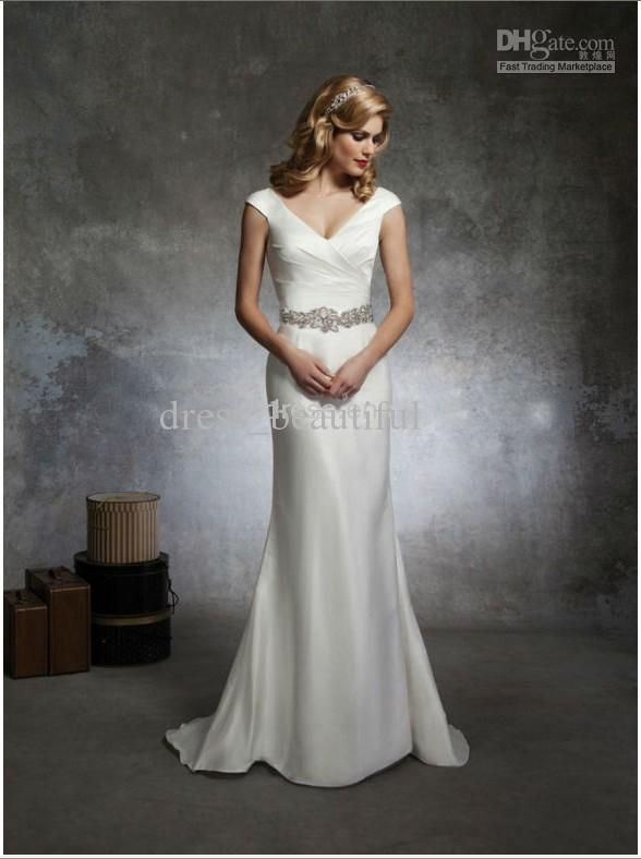 Great Justin Alexander wedding dresses style This soft trumpet style has a V neck draped in Silk Dupion accented with cap sleeves and an attached beaded