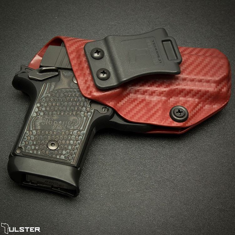 A Carbon Fiber Blood Red Profile holster for a Sig P938