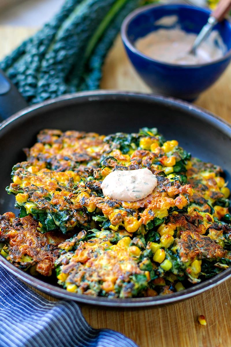 Cavolo Nero & Corn Fritters (gluten-free, nut-free, vegetarian). Cavolo nero is also known as Tuscan kale or Lacinato kale and it works brilliantly in fritters. Sweet corn adds lovely texture and sweetness. Serve with spicy mayo yoghurt sauce.