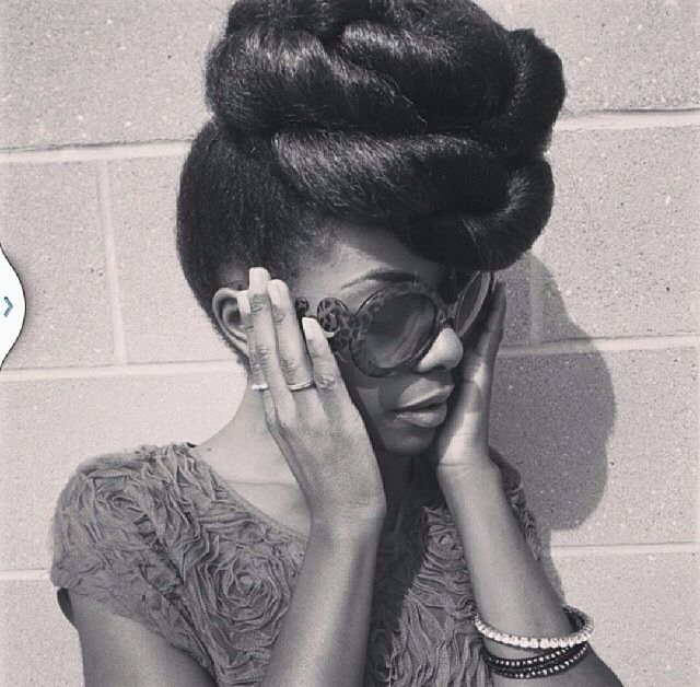 Wow, look at this twisted bun hairstyle on blown out hair ...