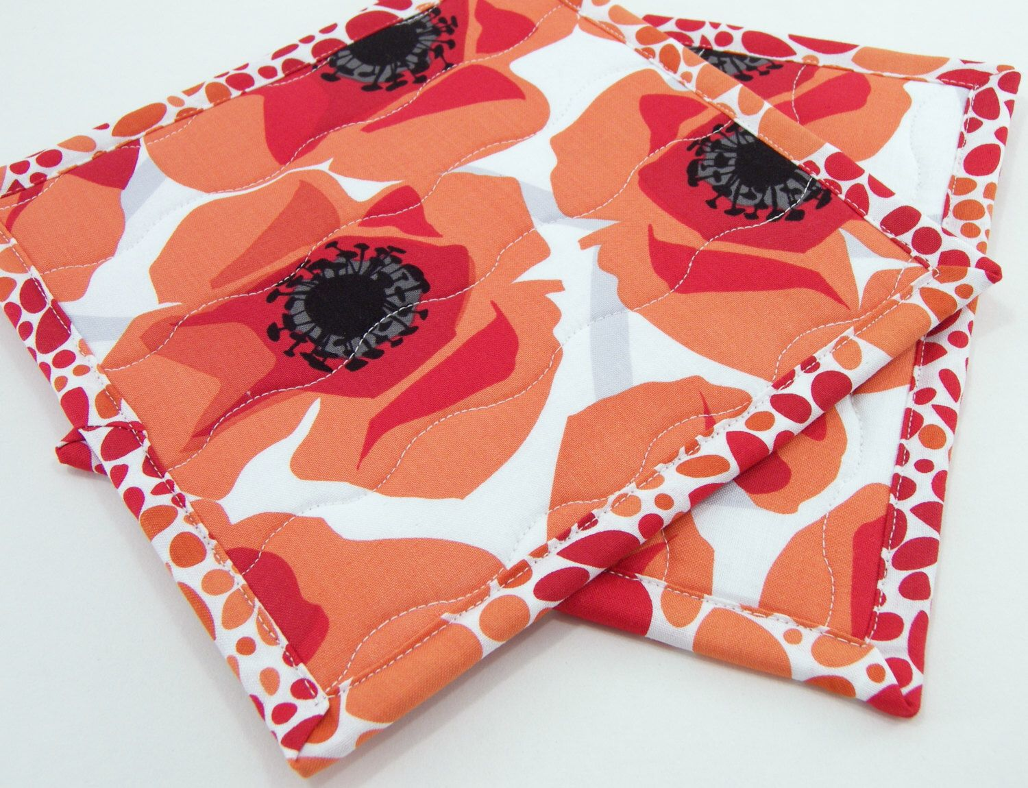 Quilted Pot Holders, Cotton Hot Pads - Orange and Red Poppies on White Floral Potholders Set of Two 8 Inch Hot Pads - Housewarming Gift by HotPotHolder on Etsy https://www.etsy.com/listing/161149669/quilted-pot-holders-cotton-hot-pads