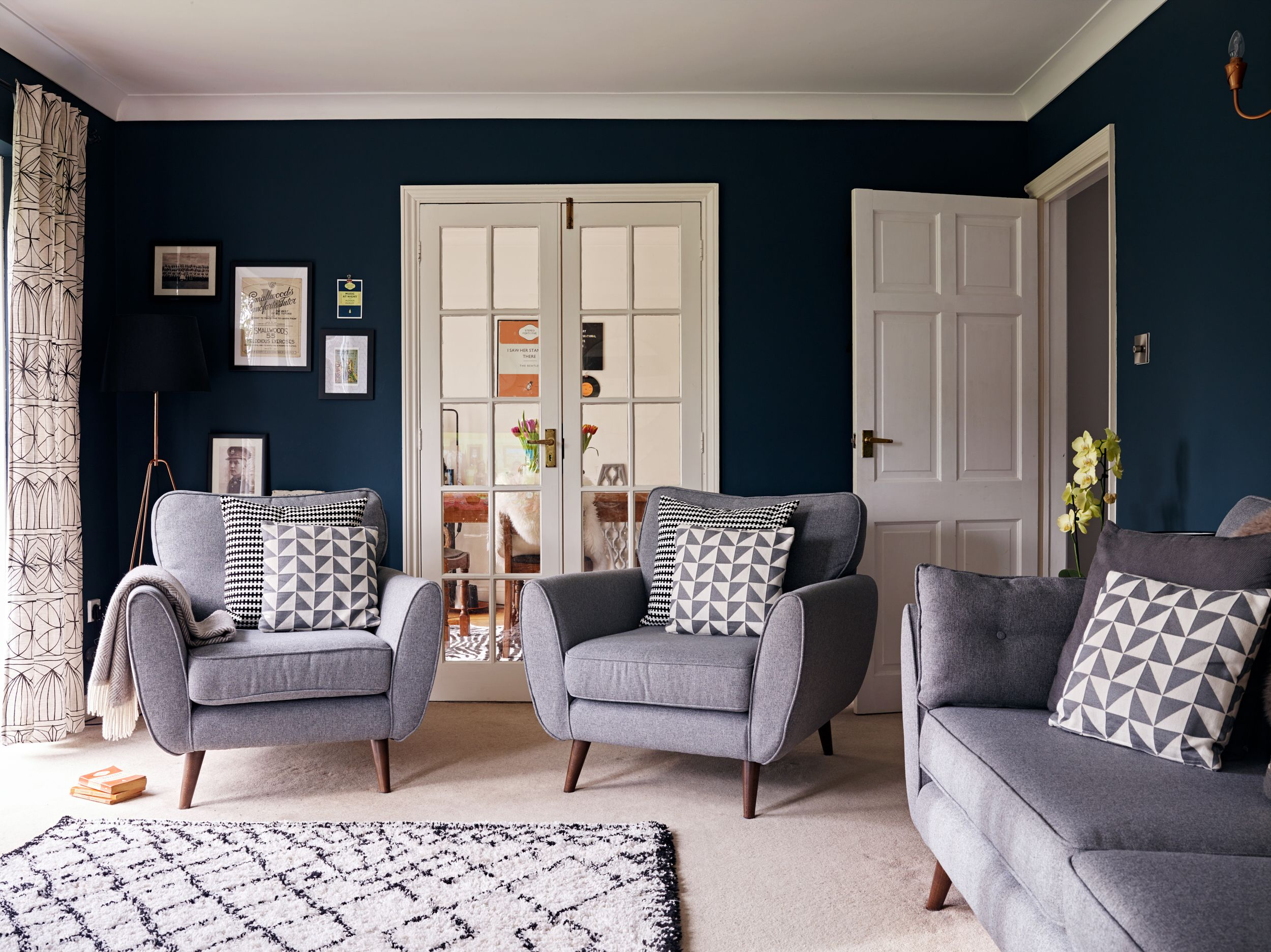 Her Grey Zinc Sofa Is The Centrepiece To The Room And Lucinda Used This As A Base To Build The O Blue Walls Living Room Blue Living Room Grey Sofa Living