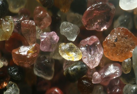 Sand from Skeleton Beach in Namibia contains rounded and polished pink-and-red garnet. Dr. Gary Greenberg, Author of A Grain of Sand