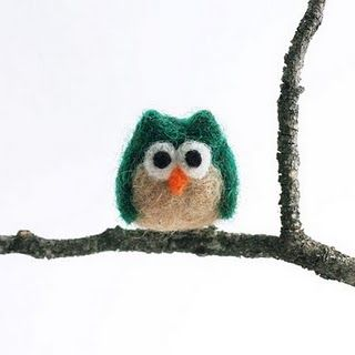 emerald green felted owl... should learn how to make these!