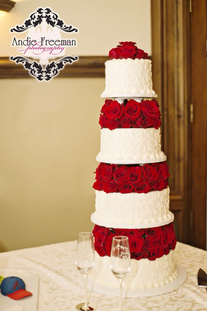 4 tier white wedding cake with red roses. Christmas wedding ...