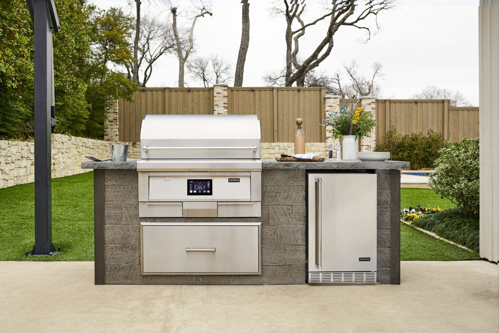Grill Smoke Sear Bake With Your Outdoor Kitchen Using One Of The New Pellet Grills From Coyo Luxury Outdoor Kitchen Outdoor Kitchen Outdoor Furniture Decor