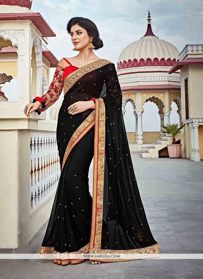 3e14888ed3 All of this accenting the feminine beauty, with this black banglori silk  designer saree. The embroidered and patch border work on attire ...