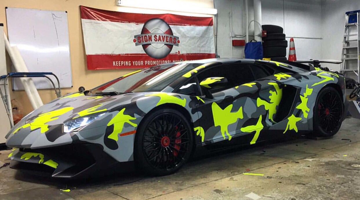 Lamborghini Aventador suoer Veloce Coupe painted in Giallo Orion and wrapped in Black, Gray and Neon Yellow camo   Photo taken by: @thsignsavers on Instagram (@pperezc on Instagram is the owner of the car)
