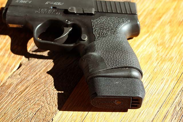 Kahr PM9 with factory 7 round magazine with Lakeline LLC