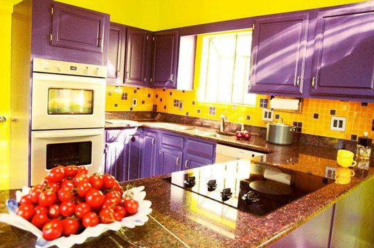 This Kitchen Is Painted And Tiled With Purple Yellow Which Are Complementary Colors These