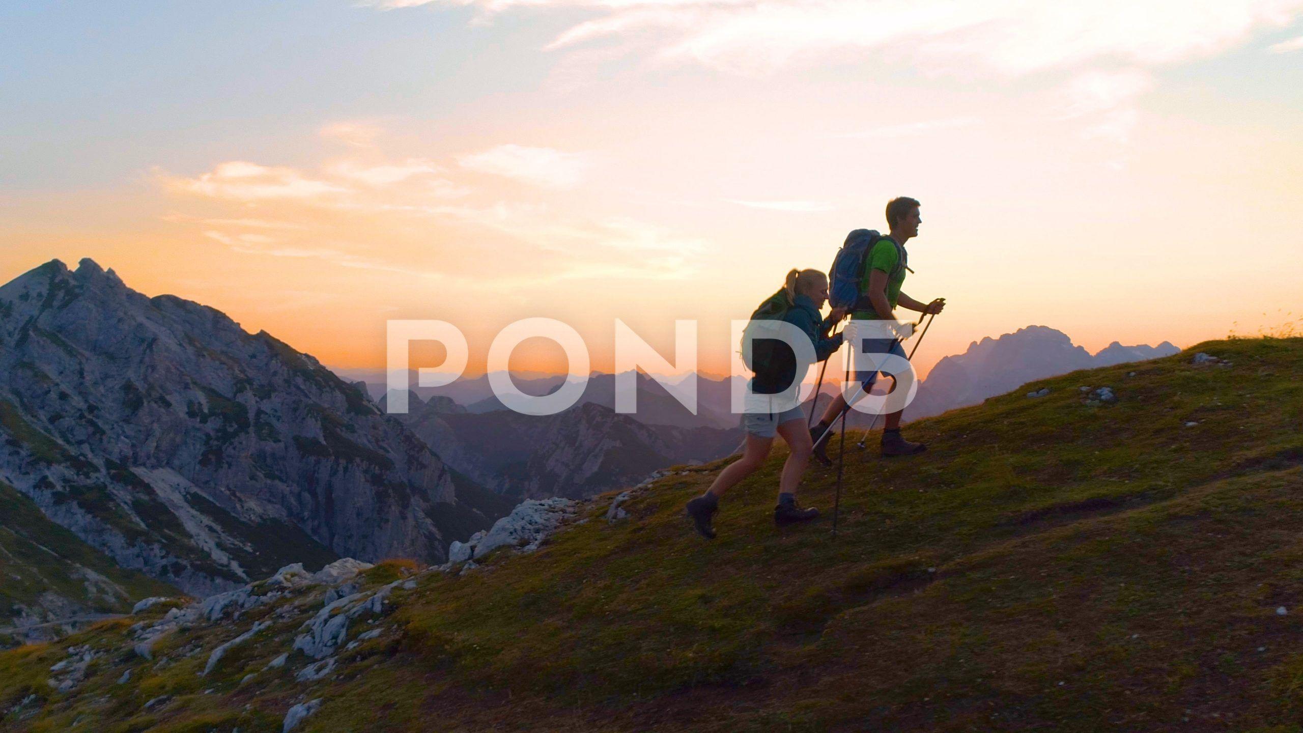 DRONE: Hiker couple enjoying an evening trip in the breathtaking Julian Alps. St…#alps #breathtaking #couple #drone #enjoying #evening