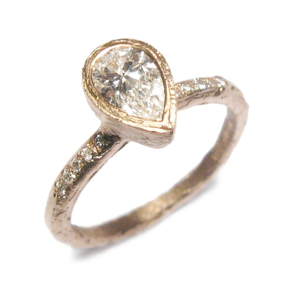 53935f24d Fairtrade rose gold ring with pear cut diamond and tiny brilliant cut  diamonds on the shank