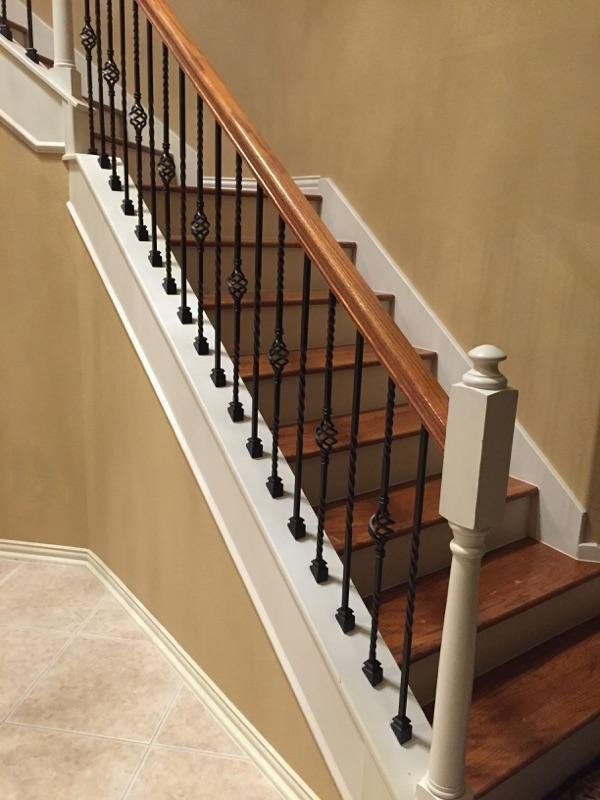 For The Erickson Staircase We Removed Their Existing Wooden Balusters And  Installed Our Powder Coated Wrought Iron Balusters In Our Old World Copper  Finish.