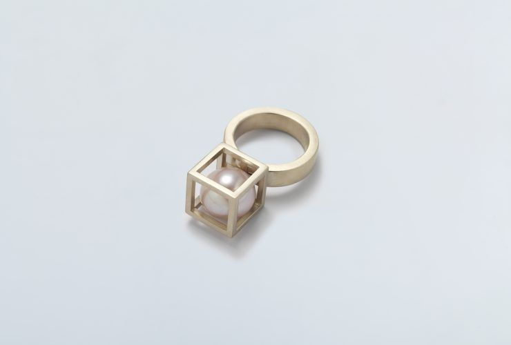 A tense pairing of shapes, bringing an architectural sensibility to the design of a jewel. A balance of freedom and constraint defines a confident, assertive ring. #LiaDiGregorio #ring •Box Collection 2007• 18Kt Yellow, White or Rose Gold & Akoya Pearl #HandMade