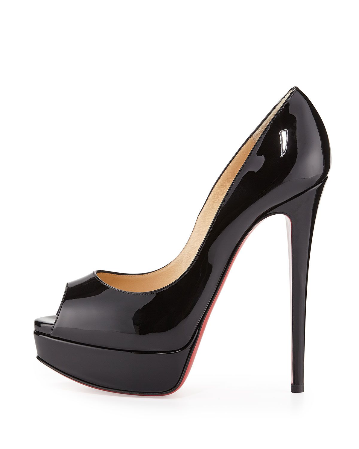 486432d71d36 Christian Louboutin patent leather pump. Peep toe sits atop 1 1 4 platform.  6 covered heel  4 1 2 equiv. Low dipped vamp visually elongates legs.