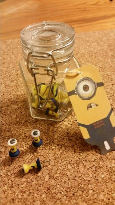 Minions P'inions - Picked all the yellow pins out of my colored pins. Used bright blue acrylic paint to the bottom half. Used a fine-topped black acrylic paint pen for the mouth. Hot glue did not work well gluing googly eyes onto the tips of the pins. I ended up carefully using Gorilla Glue. I purchased the small glass canister at Target. I found the one-eyed Minion gift tag just doing a search on Google. I then used Microsoft Paint to add, in bright orange, MINIONS P'INIONS to the Minion '…